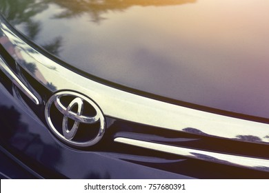SINGAPORE - OCTOBER 22, 2017: Close up of Toyota car logo on a black Toyota car. Toyota Motor Corporation is a Japanese automotive manufacturer headquartered in Toyota, Aichi, Japan.