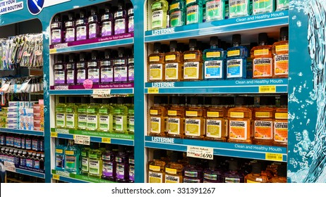 SINGAPORE ?? OCTOBER 25, 2015: Various Listerine products display on shelves in a Pharmacy of Singapore. Listerine is an American brand of antiseptic mouthwash product, founded in 1879 in St.Louis,Missouri