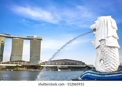 SINGAPORE - OCTOBER 27 : The Merlion fountain in front of the Marina Bay Sands hotel on October 27, 2016. Merlion is a imaginary creature with the head of a lion, seen as a symbol of Singapore