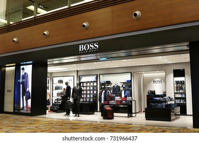 SINGAPORE - OCTOBER 4, 2017: Hugo Boss store front in Changi Airport Singapore. Boss is a German luxury fashion house founded in1924 by Hugo Boss.
