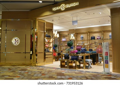 SINGAPORE - OCTOBER 4, 2017: The outer facade of the Tory Burch boutique in Changi Airport. Tory Burch is an American fashion label owned, operated and founded by American designer Tory Burch.