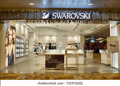 SINGAPORE - OCTOBER 4, 2017: Swarovski store front at Changi Airport, Singapore. Swarovski is an Austrian producer of crystal jewellery and accessories headquartered in Wattens, Austria.