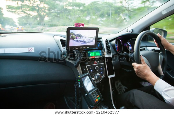 SINGAPORE, SINGAPORE - OCTOBER 5, 2018: Inside a taxi car driving around in Singapore.