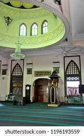 Singapore - October 6, 2018: The interior male prayer hall courtyard of the historic Hajjah Fatimah Mosque located along Beach Road in Kampong Glam area. Note the wall niche or mihrab and minbar.