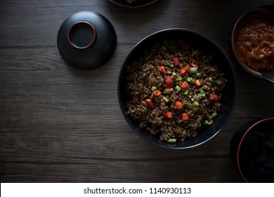 Singapore Peranakan Food Flat Lay. Peranakan Food on Wooden Table. Peranakan Fried Rice on Wooden Table with Copy Space.