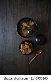 Singapore Peranakan Food Flat Lay. Peranakan Food on Wooden Table. Ngoh Hiang, Chap Chye, Nonya Peranakan Food on Wood Background with Copy Space.