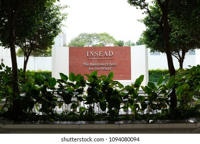 Singapore / The Republic of Singapore - February 15th, 2018: INSEAD's Singapore campus / INSEAD Business School sign on a red brick wall