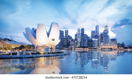 Singapore, Republic of Singapore - May 3, 2016: Panorama of Marina Bay with Artscience lotus flower museum glowing at night