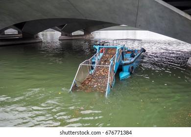 Singapore river trash collector boat.