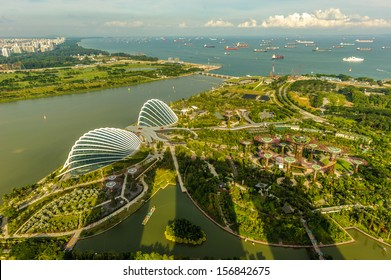 Singapore, Singapore - Sep 11 : Aerial View of the two domes of Gardens by the Bay park, Singapore with Marina Bay Sands towering shadows on September 11, 2013
