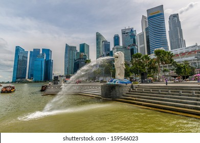 Singapore - September 11 : Singapore Merlion against the new city skyline with Marina Financial centre taken in the day of September 11, 2013.
