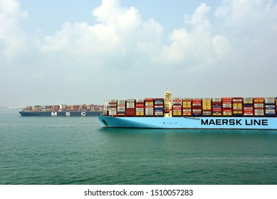 Singapore / Singapore - September 12 2019: Large fully loaded container ship, owned by Maersk Line arriving to the port of Singapore.