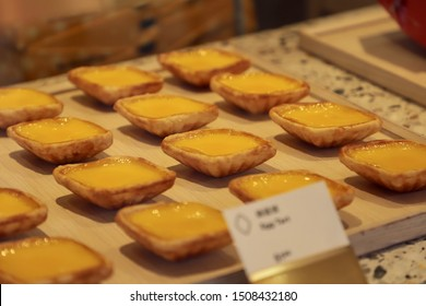 Singapore, Singapore - September 12, 2019: Tong Heng's egg tarts for sale; on display at the store's window.