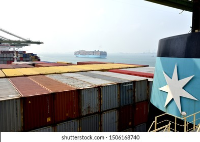 Singapore / Singapore - September 12 2019: View on the cargo and the funnel of the Maersk container ship during her port stay in the Singapore.