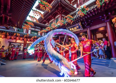 Singapore - September 15, 2016: Lion dance performance in a pagoda in Chinatown Singapore, where cultural values are still standing firmly regardless of urban development.