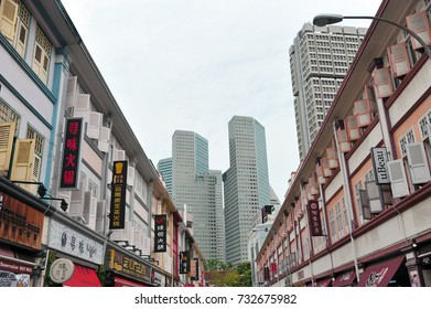 Singapore, Singapore -September 16 : Rows of shophouses along Liang Seah Street in the foreground and SUNTEC City in the distance taken in the day of Sept 16, 2017..