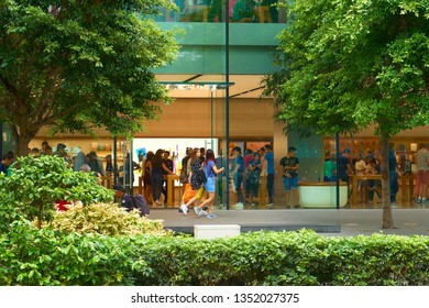 SINGAPORE - SEPTEMBER 2, 2018: Locals and tourists on the lively streets of Asian metropolis.