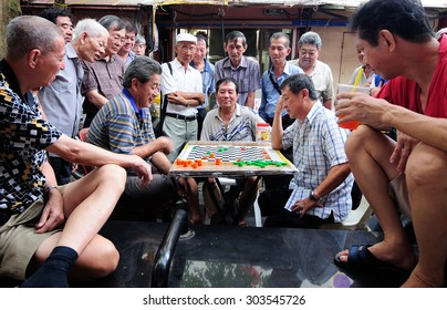 Singapore, September 2012. Unidentified local people played chinese chess in Chinatown street market.