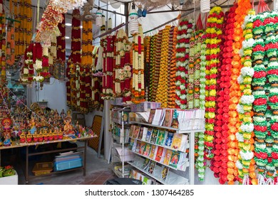 SINGAPORE - SEPTEMBER 2018 : Colorful Marigold flower garlands, other offerings to offer to God during worship at little India, Singapore in September 9, 2018