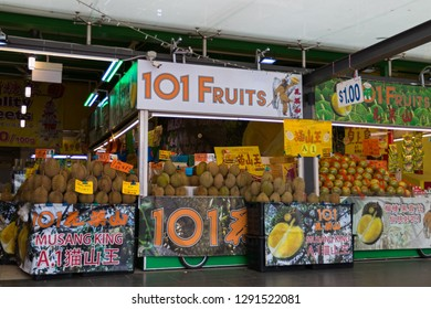 SINGAPORE - SEPTEMBER 2018 : Durian stalls selling in a market in Chinatown in Singapore on September 16, 2018.