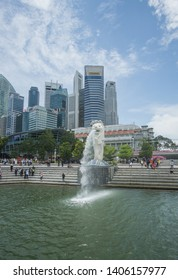 Singapore  , Singapore - September 22nd , 2018.  The Merlion statue in a beautiful day around the Marina bay in Singapore , this iconic place will blow your mind with its famous buildings.