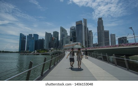 Singapore  , Singapore - September 22nd , 2018.  People walking around in a beautiful day at the Marina bay in Singapore,this iconic place will blow your mind with its famous landmarks.