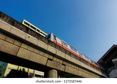 SINGAPORE  - SEPTEMBER 25, 2018: Singapore mass rapid train (MRT) travels on the track. The MRT has 106 stations and is the second-oldest metro system in Southeast Asia.