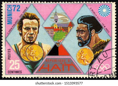 SINGAPORE – SEPTEMBER 25, 2019: A stamp printed in Haiti shows Viren and Milburn, Gold Medal Winners, 1972 Summer Olympic Games, Munich, circa 1972