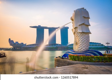 SINGAPORE - SEPTEMBER 3, 2015: The Merlion statue fountain and the Singapore skyline. The landmark statue is considered the personification of Singapore.