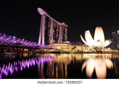 SINGAPORE - SEPTEMBER 30, 2016: Marina Bay Sands and Helix Bridge at night