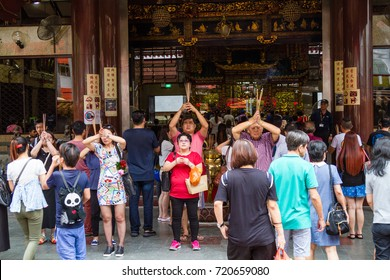 SINGAPORE - SEPTEMBER 7, 2017: Worshipers flock to the historical Kwan Im Thong Hood Cho Temple to pray during the Hungry Ghost Festival.The temple has a history dating back to 1884.