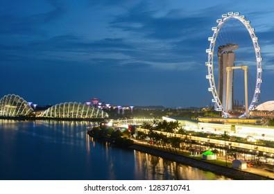 Singapore - September 9, 2018: Singapore Flyer and Marina Bay landscape at night