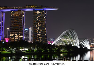 Singapore - September 9, 2018 - Marina Bay Sands and Gardens by the Bay in Singapore at night
