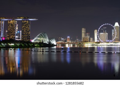 Singapore - September 9, 2018: Singapore skyline at night reflecting in the water of Marina Bay