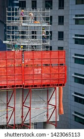 Singapore, Singapore/Singapore  - June 09 2019:High rise construction workers in action on buildings modern building in Singapore
