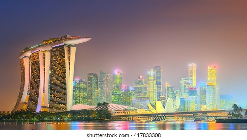 Singapore - SIRCA MAY 2015: Marina Bay skyline and view of Marina Bay Sands at twilight. The Marina Bay is a bay near Central Area in of Singapore and lies to the east of the Downtown Core.