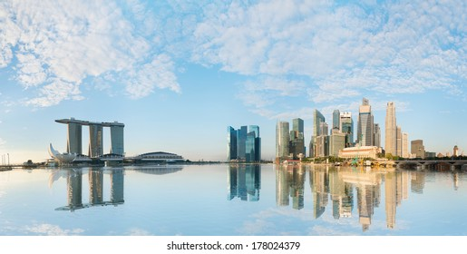 Singapore skyline of business district with skyscrapers and Marina Bay Sands at morning under blue sky