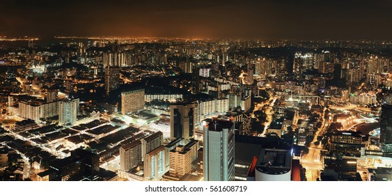 Singapore skyline from at night with urban buildings