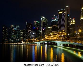Singapore skyline at night with urban buildings. November, 2017