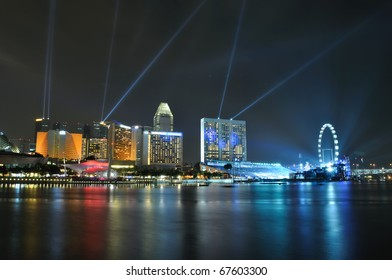 Singapore skyline and river at night