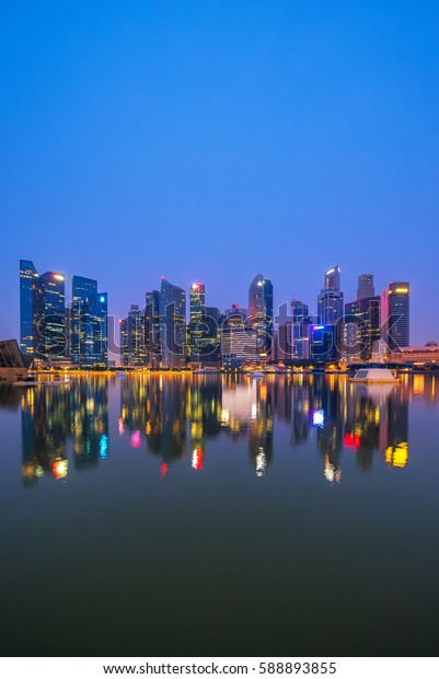 Singapore Skyline. Singapore`s business district, blue sky and night view for marina bay