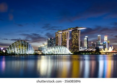 Singapore Skylines, Downtown and Financial District buildings reflection along the Singapore River at Blue Hour. Modern City Background. Urban night view.