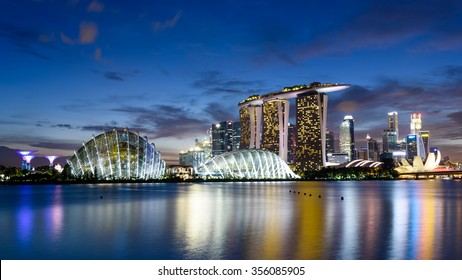 Singapore Skylines, Downtown and Financial District buildings reflection along the Singapore River at Blue Hour. Modern City Background. Urban night view. Panoramic style