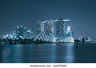 Singapore skyscraper in marina bay at night