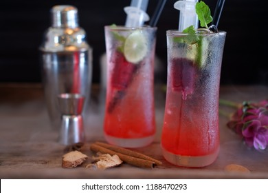 Singapore sling cocktail on old wooden and smoked cocktails