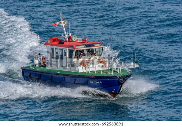 SINGAPORE STRAIT, MALAYSIA - January 06, 2017: Pilot boat at full speed in the waters of the Singapore strait, Malaysia