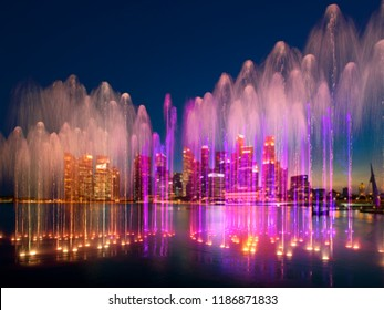 SIngapore water show with city skyline in background