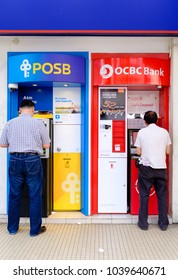 SINGAPORE-04 MAR 2018: people withdraw money from Singapore most popular bank ATM machine,POSB and OCBC
