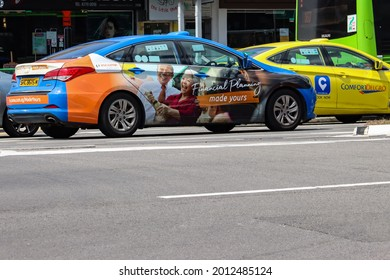 """SINGAPORE-22 JUL 2021.  A blue Comfortdelgro taxi displays advertisements. Car owners like taxi operators, earn income if they put ads on their cars - a procedure known as """"vehicle wrapping""""."""