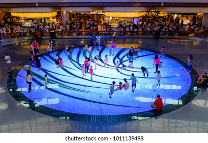 SINGAPORE-27 JAN 2018:people play on the light playground in Singapore marina bay shopping mall lobby